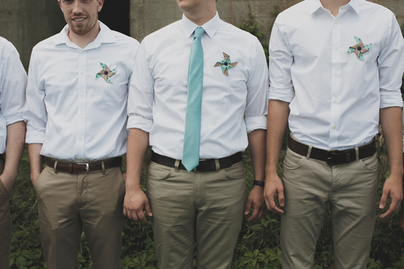 blue groomsmen tie and pinwheel boutonnieres
