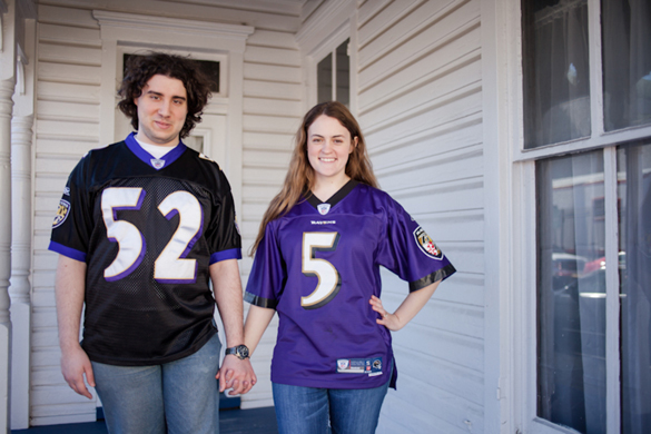 couple wearing football jerseys