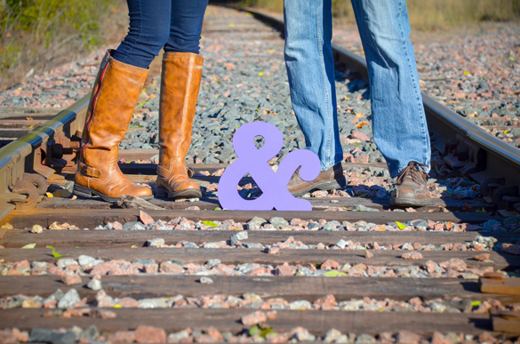 adorable boot shot with ampersand wedding sign